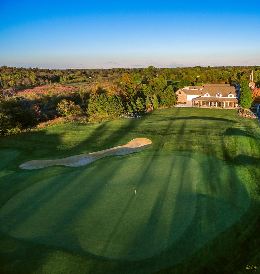 A flyover view of the clubhouse and one of the holes on the course at The Barn at The Bog